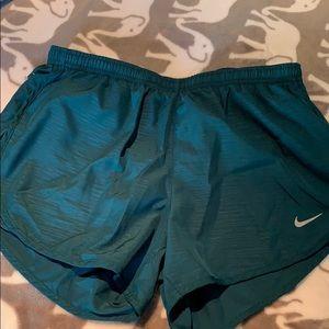 Green Nike running shorts